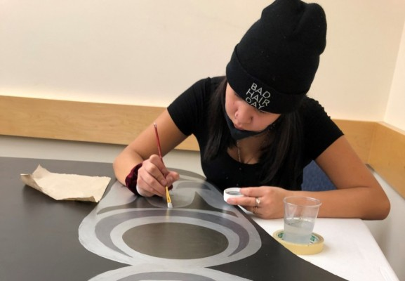 Grade 8 student, Jolene Sam, works on the 2-D canoe at ADSS. (Photo supplied by Geena Haiyupis)