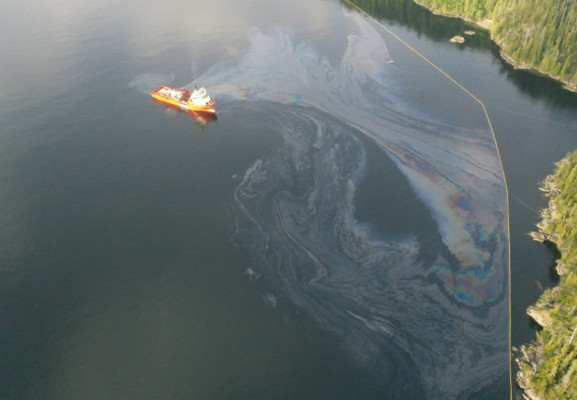 Oil containment booms protecting shoreline of Bligh Island. (Unified Command Information Site photo)